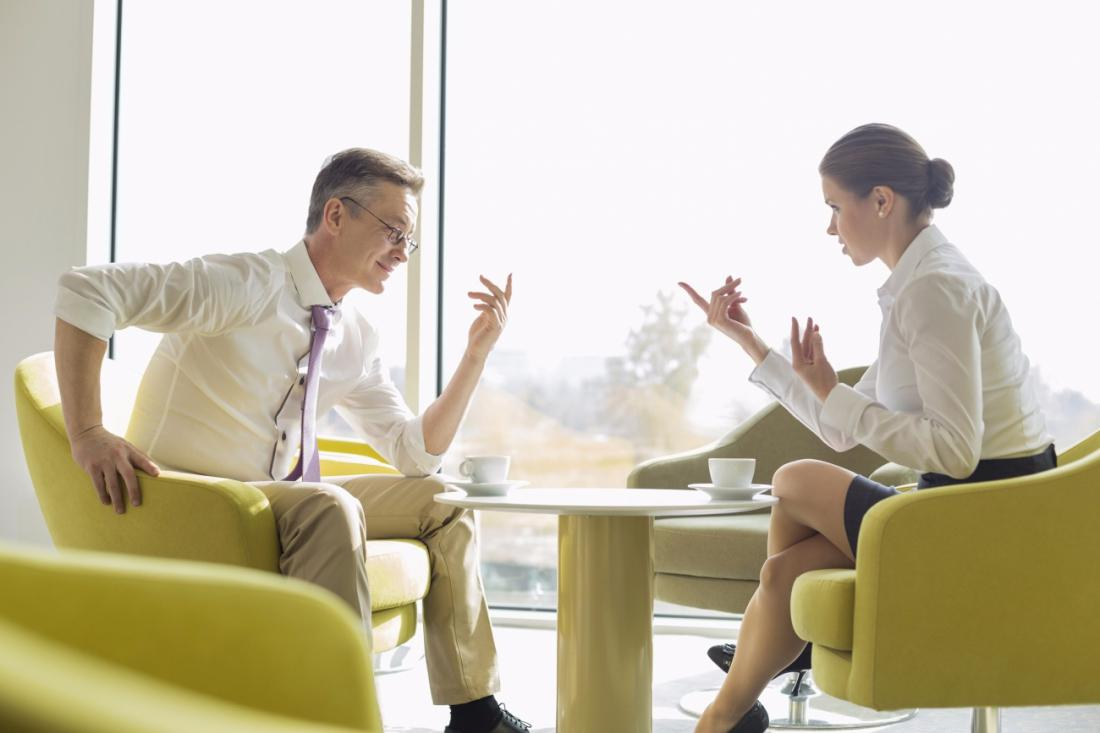 Businessman Wearing Glasses And Red Tie Preparing For Negotiation Stock Photo
